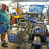 BMW &quot;Bench Mark Works&quot; : Errol &amp; Sean Weaver, proprietors of &quot;Bench Mark Works&quot; , .....  B.M.W.  .... , a custom shop specializing in BMW motorcycle vintage parts and restorations are located in the tiny hamlet of Milford, Ontario, Canada. The featured bike in for engine repairs this week is the original German Army motorcycle c/w sidecar that was used in the 1966-68 television series &quot;The Rat Patrol&quot;.  PS: The owner pulled the side-car mounted machine-gun prior to shipping!